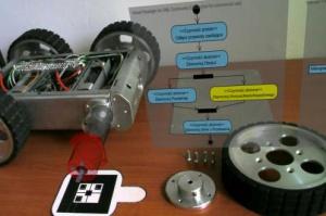 Rys. 5a. Przykładowe zastosowania systemu AR do wspomagania obsługi rzeczywistych robotów